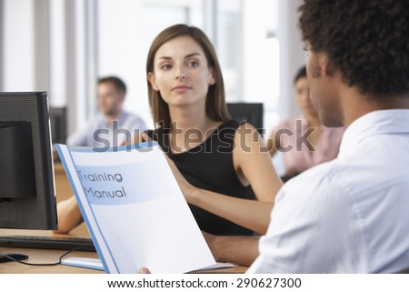 New Employee Starting Work In Busy Office - stock photo