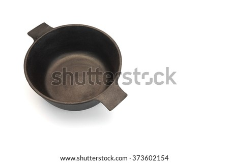 New Empty And Clean Classic Cast Iron Dutch Oven Or Pot Isolated On White Background, Close Up, Overhead View, Horizontal Image, Studio Shot - stock photo