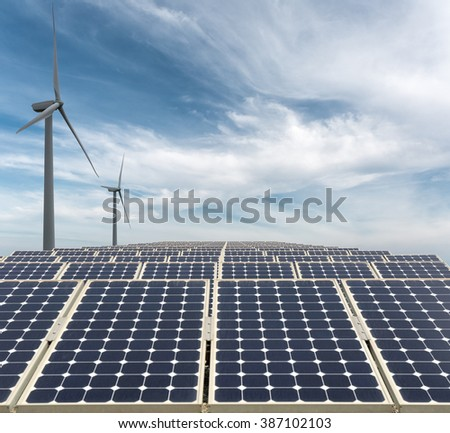 new energy background, solar panels and wind power against a blue sky.