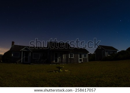 New England cabin at night