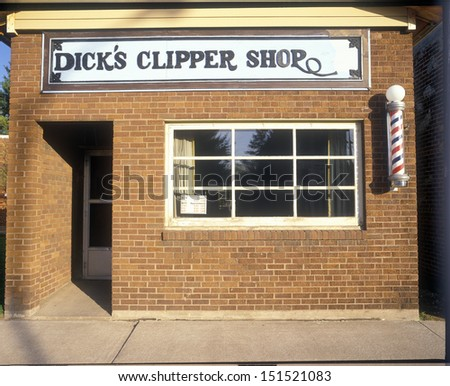 NEW ENGLAND - CIRCA 1980's: Brick barbershop building