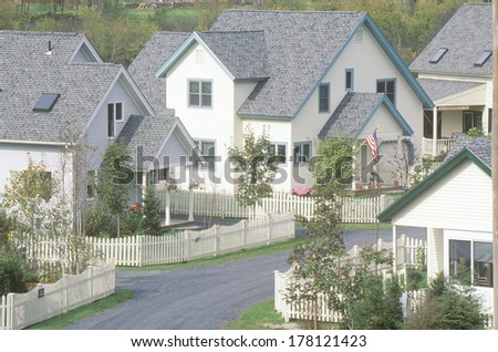 New England neighborhood with white picket fences