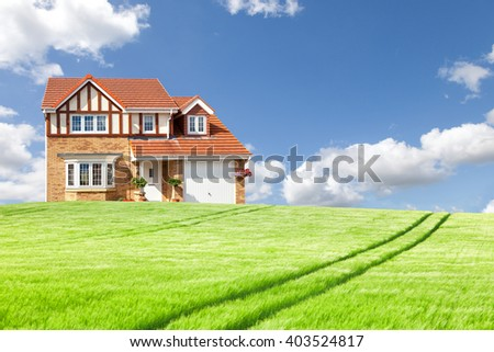 New english house and green field