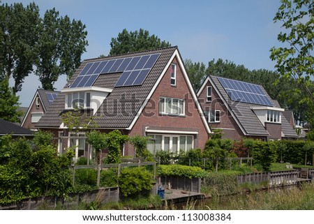 new family building with solar panels - stock photo