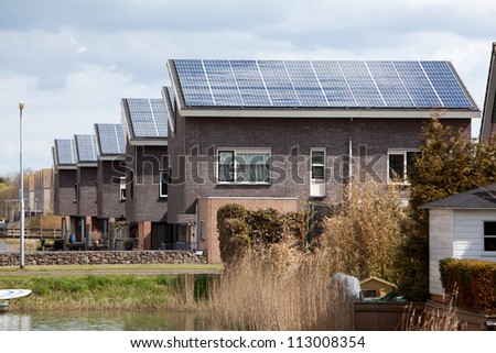 new family building wth solar panels - stock photo