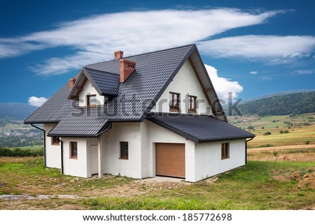 New family house in the mountains - stock photo
