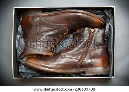 New fashionable leather shoes. Gift box with a shoe  - stock photo