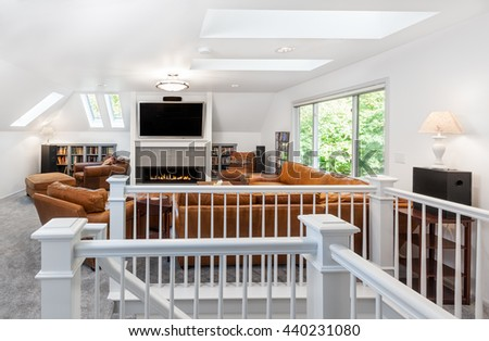 New fireplace, skylights and seating complete the media/reading room - stock photo