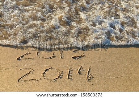new for 2014 written in beach sand