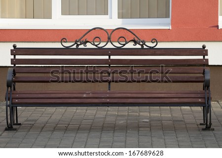 New forged bench at the building. - stock photo