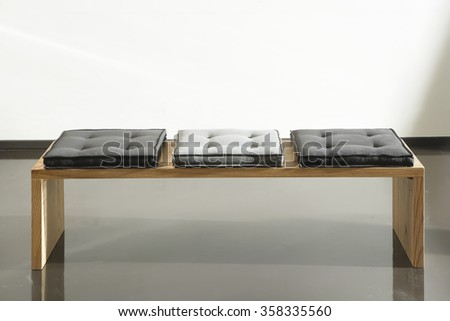 NEW FURNITURE LINE , MODERN DESIGN,  STRAIGHT LINES , MATERIALS : WOOD,  FABRIC . RECTANGLE BENCH - stock photo