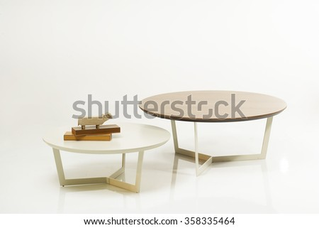 NEW FURNITURE LINE , MODERN DESIGN,  STRAIGHT LINES , MATERIALS : WOOD, METAL . ROUND WOODEN TABLE SET - stock photo