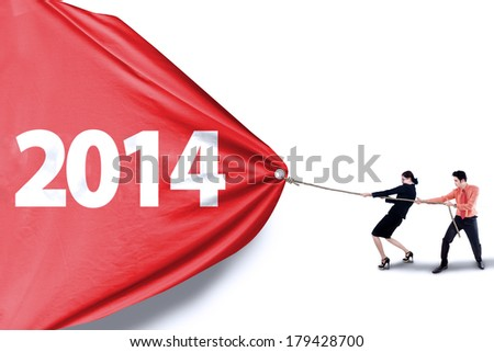 New future business concept with business teamwork pulling number of 2014 - stock photo