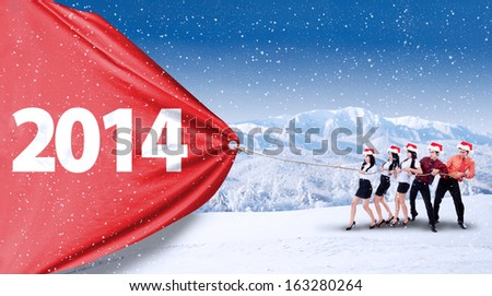 New future business concept with business teamwork pulling number of 2014 outdoor - stock photo