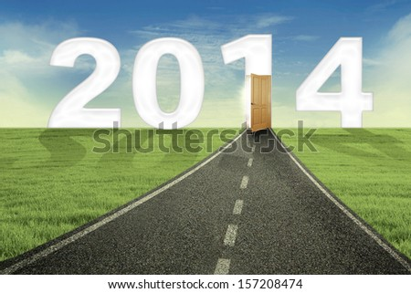 New future concept with the road and open door to new future in 2014 - stock photo