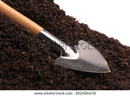 New garden shovel on the organic soil over white background - stock photo
