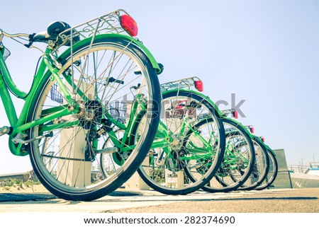 New green bicycles lined up on the road - Detail of wheels at bycicle sharing point - Modern concept of ecological transportation - Bike urban transport - stock photo
