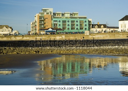 New green copper fronted flats on redeveloped promenade in Porthcawl, South Wales, UK.