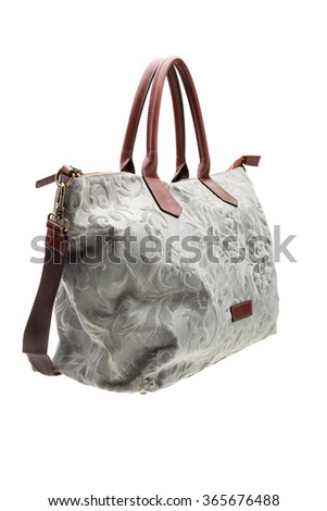 New grey patterned womens bag with brown handles isolated on white background. - stock photo