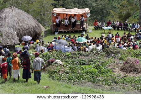 NEW GUINEA, INDONESIA -DECEMBER 31:Christian preaching in the Papuan village of Baliem Valley on New Guinea Island, Indonesia on December 31, 2010 - stock photo