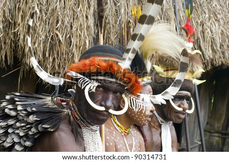 NEW GUINEA, INDONESIA -DECEMBER 28: Unidentified people of a Papuan tribe in traditional clothes and coloring in New Guinea Island, Indonesia on December 28, 2010 - stock photo