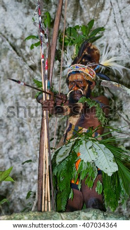 NEW GUINEA, INDONESIA - 13 JANUARY: Warriors tribe Yaffi in war paint with bows and arrows in the cave. New Guinea Island, Indonesia. January 13, 2009.