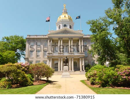 New Hampshire State Capitol Building and Daniel Webster statue - stock photo