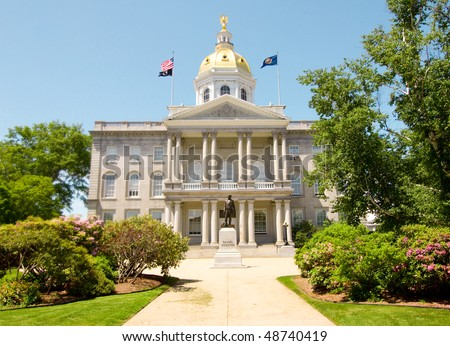 New Hampshire State House and Daniel Webster statue - stock photo