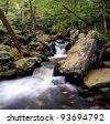New Hampshire stream with small waterfall in the spring - stock photo