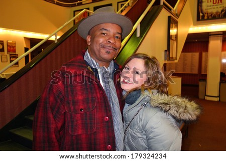 NEW HAVEN, CONNECTICUT- JANUARY  25, 2014:  Emmy winner  David Alan Grier and Broadway actress Felicia Ricci (Wicked) arrive at the Shubert Theater to perform in the Yale Alumni musical, My Fair Lady - stock photo