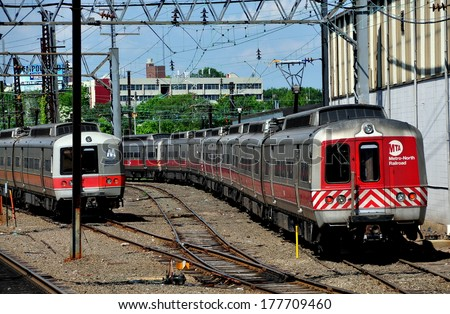 New Haven, Connecticut - June 20, 2013 :  A Metro-North MTA commuter train (right) in the train yards approaching Union Station - stock photo