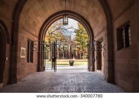 NEW HAVEN, CONNECTICUT - NOVEMBER 8, 2015: Seen here is a view of Phelps Gate at Yale University looking in towards the campus with people visible in the distance. - stock photo