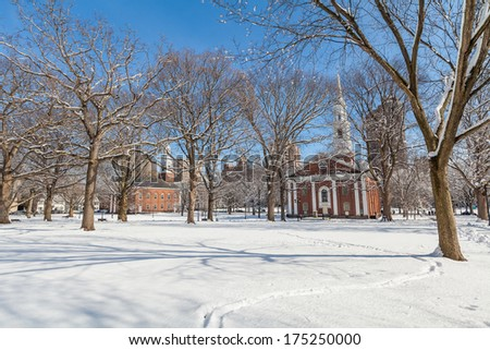 New Haven Green with snow and blue sky: a park in downtown New Haven, CT used for public events and bordered by Yale University. Stock Photo:  - stock photo