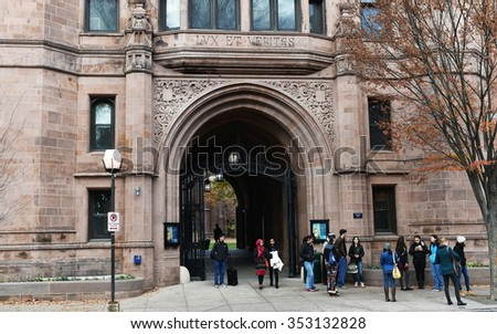 NEW HAVEN, USA - NOV 14, 2015: People gather at a building on the campus of Yale University. Founded in 1701 the ivy league college has a current enrollment of over 12,000 students.. - stock photo
