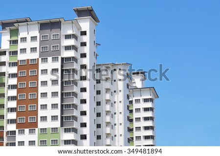 New high luxury apartment building at suburban area with blue sky - stock photo