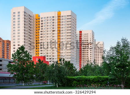 New high-rise residential building in Moscow suburb during golden hour - stock photo