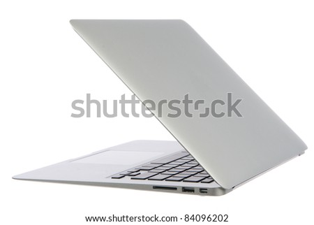 New high-speed thin silver aluminum laptop computer notebook side with touchpad, keyboard and open slots isolated on a white background - stock photo