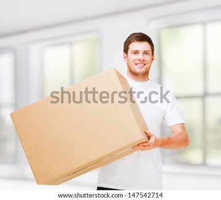 new home and post delivery concept - smiling man carrying carton box - stock photo