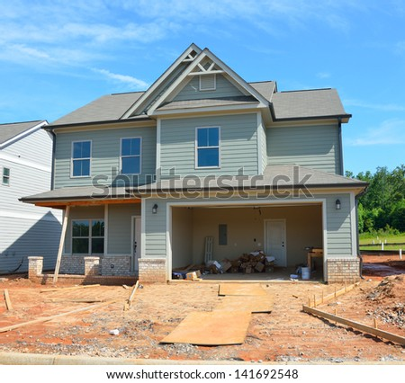 New home being constructed to sell al Georgia, USA. - stock photo