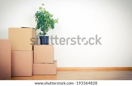 New home concept. Boxes in empty room. - stock photo