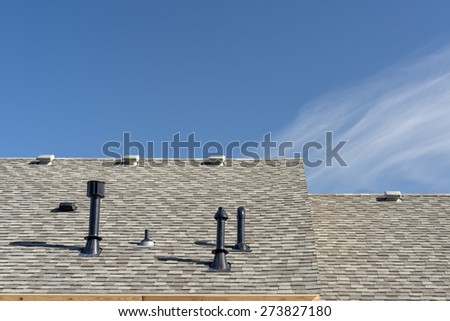 New home construction roof with utilities - stock photo