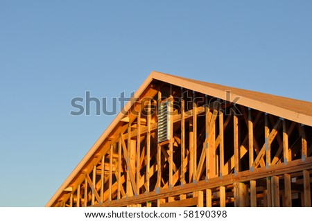New Home Roof Under Construction - stock photo