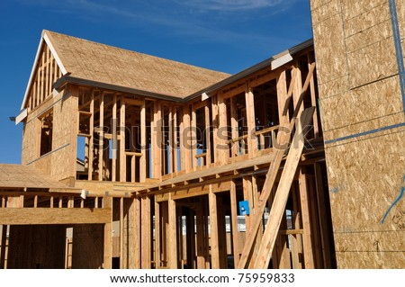 New Home Under Construction Good Blue Sky - stock photo