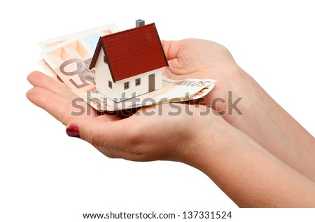 New house and money isolated over white - stock photo