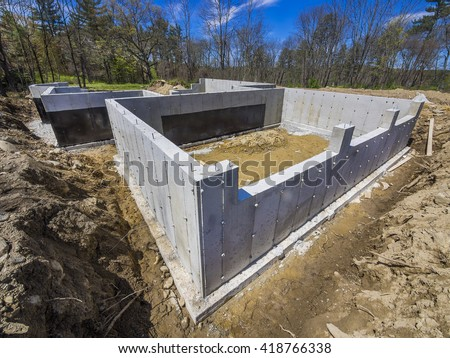 New house concrete foundation - stock photo
