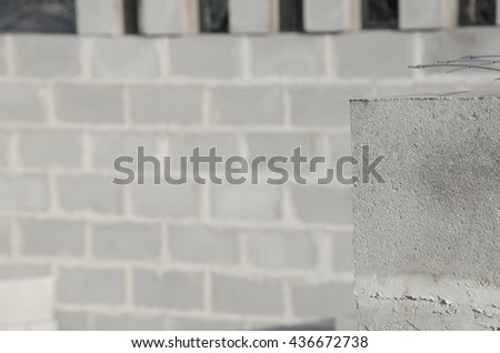 New house construction, building foundation walls using concrete blocks, copy space. - stock photo