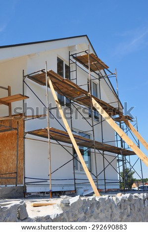 New house facade thermal insulation and painting works.