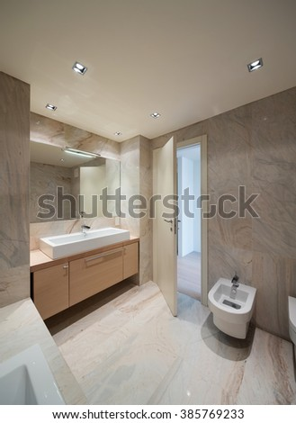 New house,  inside  the marble bathroom with basin modern design