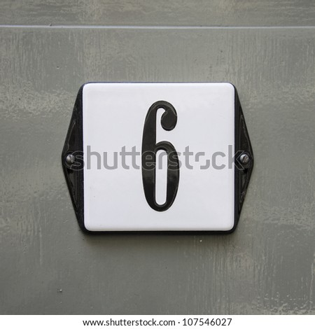 new house number six on an enameled plate