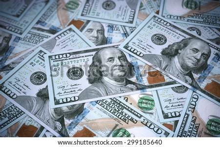New Hundred dollar banknotes closeup (depth of field) - stock photo